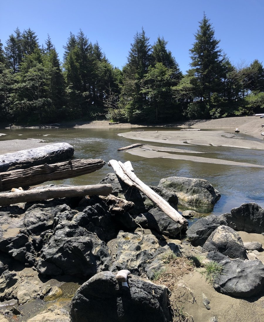Hopping into muddy sand to ford this river on the West Coast Trail