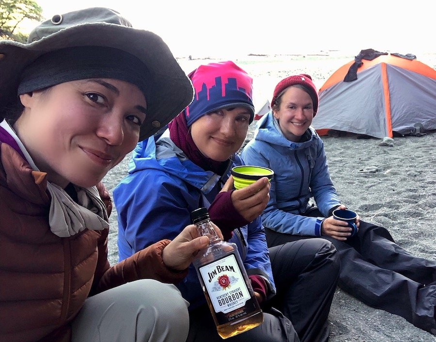 Sharing bourbon with women hikers at Camper Bay, West Coast Trail