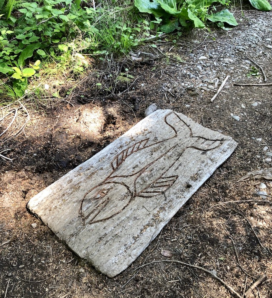 First Nations carving in a board on the West Coast Trail