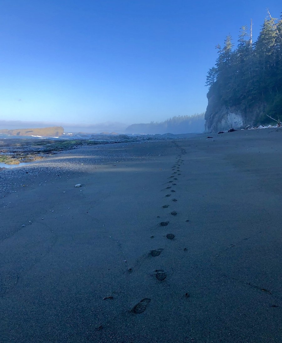 My footprints in the sand leaving Tsusiat Falls on the West Coast Trail