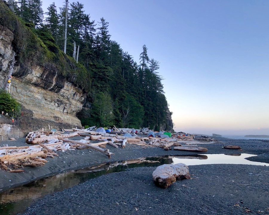 Tsusiat Falls camp area in early morning on the West Coast Trail