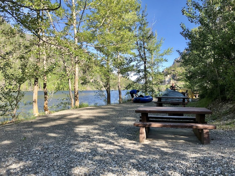 A tightly packed row of lakeside campsites at Marble Canyon Provincial Park's campground