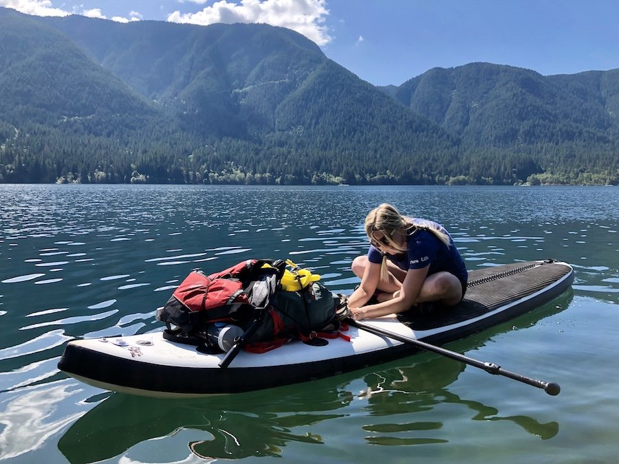 Stretching out the back on an SUP Paddleboard at Alouette Lake Golden Ears Provincial Park