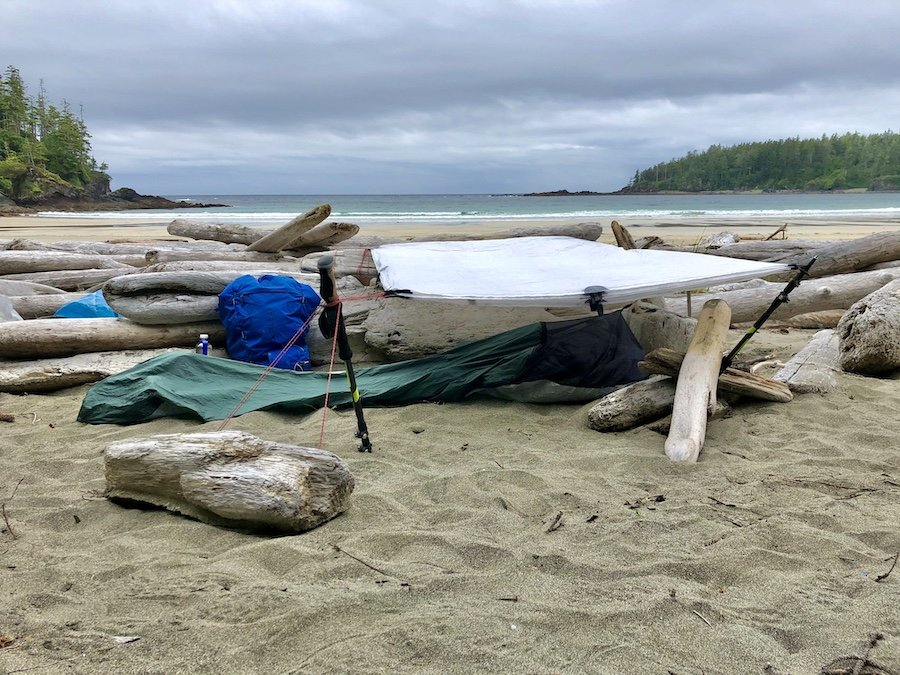 Bracing for a windy night with my bivy and tarp set-up to camp at Guise Bay, Cape Scott Trail, Cape Scott Provincial Park